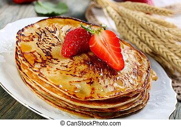 Pancakes with honey sauce.
