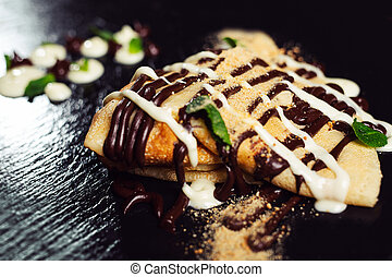 Pancakes with Ice Cream and chocolate. Top view.
