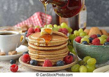 Pancakes with maple syrup and berries