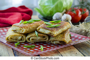 Pancakes with meat - Fried pancakes twisted with meat inside...