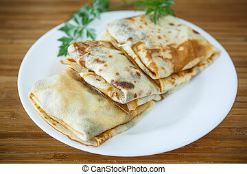 Pancakes with meat - traditional pancakes wrapped inside ...