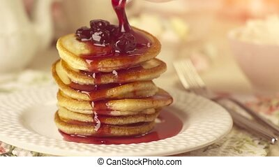 Pancakes with pouring cherry jam
