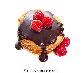 Pancakes with raspberries and chocolate sauce. Isolated on white background