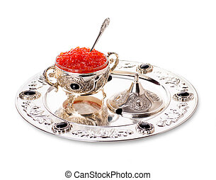 Pancakes with red caviar on silver ware