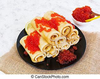 Pancakes with red caviar.