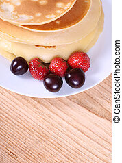 pancakes with ripe berries.