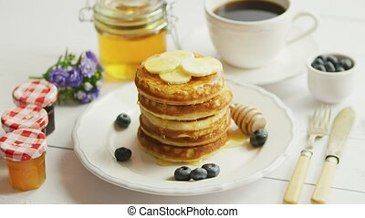 Pancakes with slices of banana and berries - From above view...