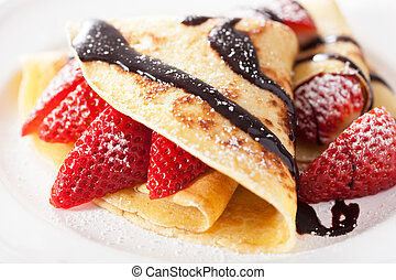 pancakes with strawberry and chocolate sauce