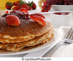 Pancakes with strawberry preserves - A plate of large...