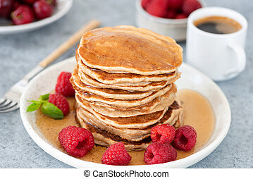 Pancakes with syrup and raspberries