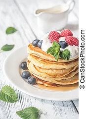 Pancakes with whipped cream and fresh berries