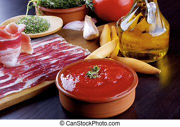 Pancetta and Ingredients with Tomato Sauce, Garlic, Rosemary and Bread Sticks, Spices and Olive Oil closeup on Dark Wooden background
