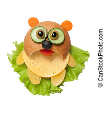 Panda made of bread, cheese and vegetables on isolated background