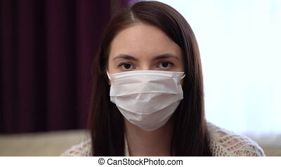 Young Woman Wearing Protective Mask at Home