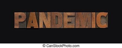 Pandemic word in wood type on black