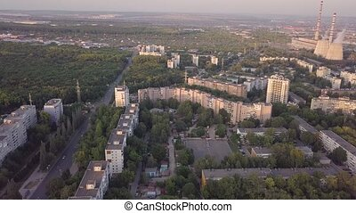 Soviet Union city panorama from sky - Panel concrete houses typical blocks city with park, hospital, and industrial zone, aerial view