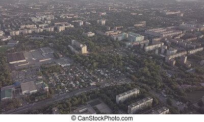 Soviet Union city panorama from sky - Panel concrete houses typical blocks city with park, hospital, village, aerial view