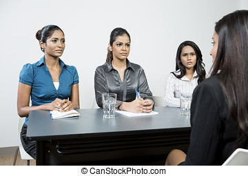 Panel of colleagues interview applicant - Three Indian...