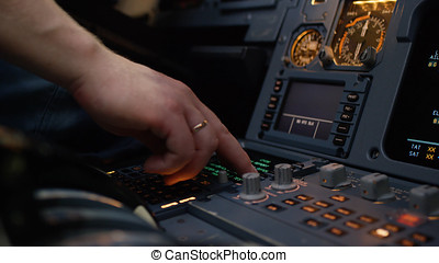 Panel of switches on an aircraft flight deck. Autopilot control element of an airliner. Pilot controls the aircraft. Onboard computer, cockpit
