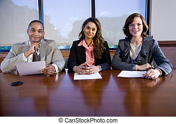 Panel of three multiracial businesspeople