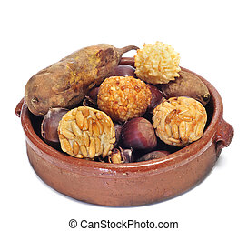 panellets and roasted chestnuts and sweet potatoes, a typical dish of Catalonia, Spain, in All Saints Day