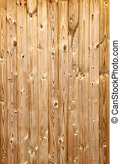 Panels in a pine wood fence close up.