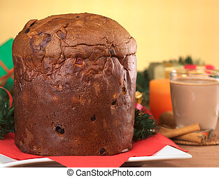 Panettone is a traditional Christmas cake, which is originally from Italy, but is enjoyed now also in many South American countries (Selective Focus, Focus on the front of the cake)