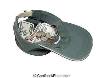 Panhandling - A worn baseball hat used to hold money while...