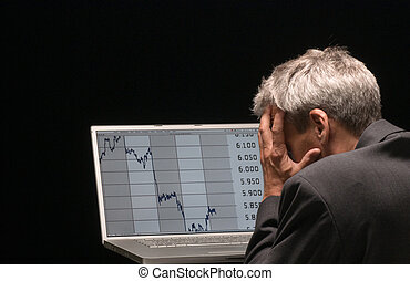 panic - desperated man with charts on his laptop