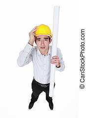 Panicked engineer holding a rolled-up drawing
