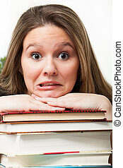 Panicked student with books - A college student up to her...