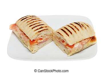 Panini - Ham, tomato and melted cheese panini on a plate ...