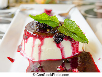 Panna cotta dessert with raspberry jam blueberries...