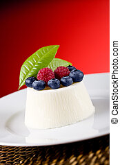Panna cotta with Berries on red background - photo of...