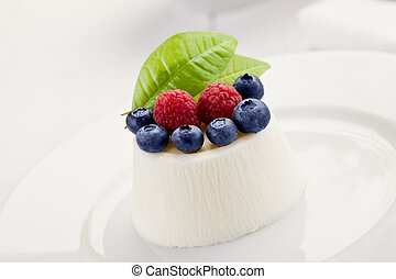 Panna cotta with Berries on white table - photo of delicious...