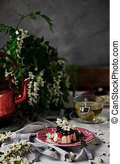 pannacotta with acacia flowers and cherry sauce..selective...