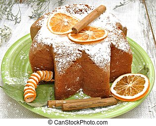 Panneton decorated with orange slices and cinnamon, with...