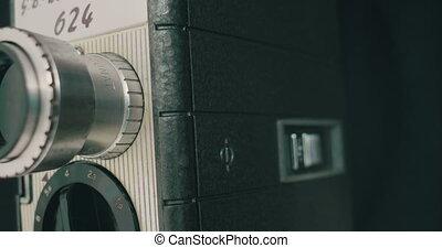 Panning a 8 mm Film Camera - A retro old film camera on...