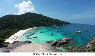 Panning Across a Crowded Tropical Beach in the Similan Islands of Thailand