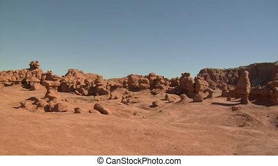 panning across boulders in goblin Valley Utah
