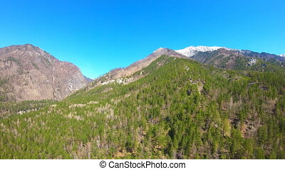 Panning Aerial View of mountain landscape. Camera moves over...