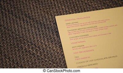 Panning food menu on textured background. Food and beverage...