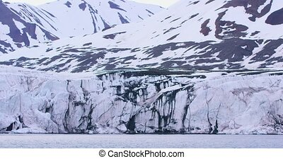 Panning of a massive glacier in the arctic - Close-up of the...