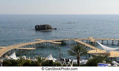 Panning of beach at luxury hotel
