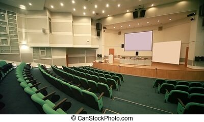 panning of empty conference hall with seats