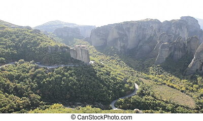 Panning of view from above on the Rousannou - St. Barbara monastery, Meteora, Greece