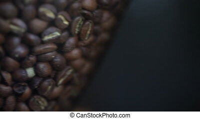 Panning Shot of Coffee Beans - A close up, panning, shot of...