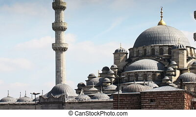 panning shot of the yeni cami mosque in istanbul, turkey
