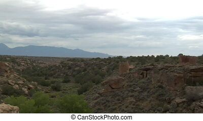 panning shot revealing ruins at at Hovenweep national Monument