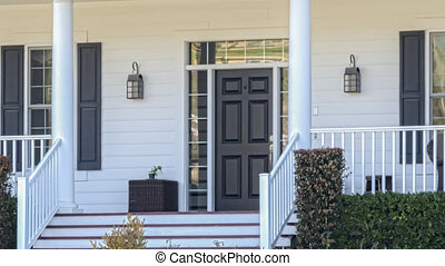 Panning Sold Home For Sale Real Estate Sign and Beautiful House.